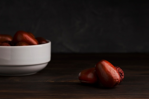 Date fruits on wooden table