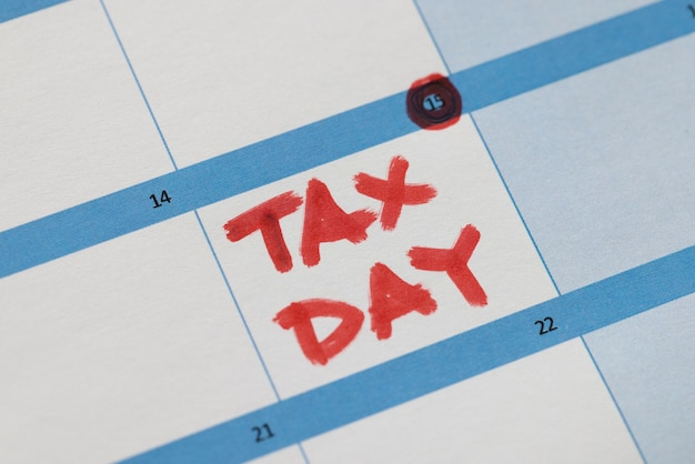 Date of tax filing is marked in red on calendar. tax return concept