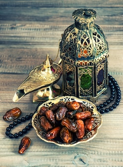 Dates, arabic lantern and rosary. oriental decoration. retro style toned picture