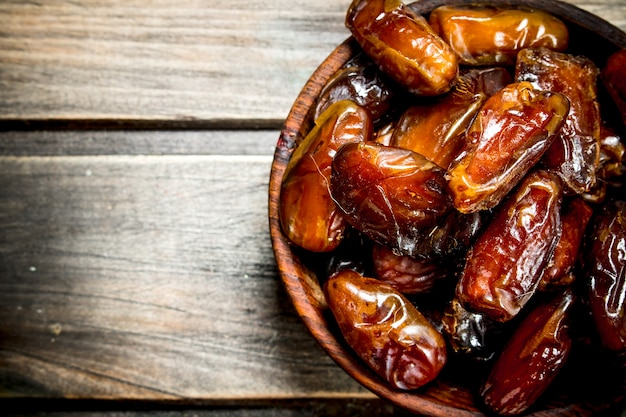 Dates in bowl. on a wooden.