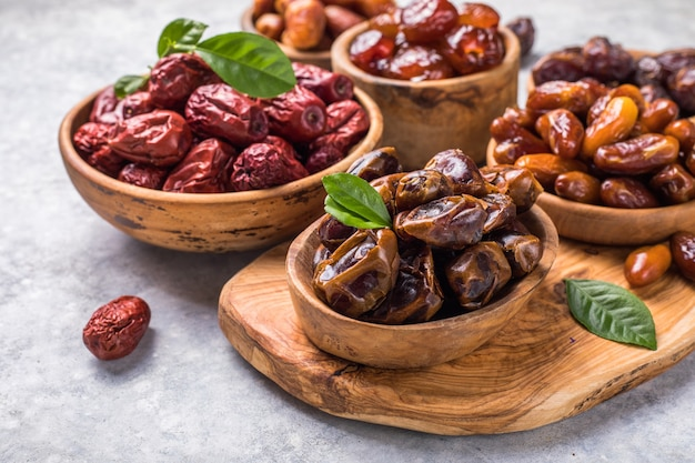 Dates or dattes palm fruit in wooden bowl