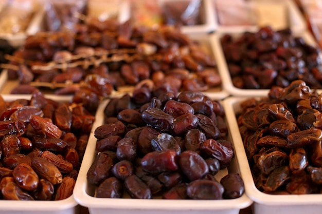 Dates, dried fruits, on the market counter.