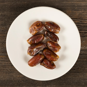 Dates fruit on plate on table
