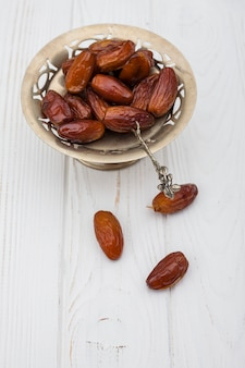Dates fruit on small plate on table