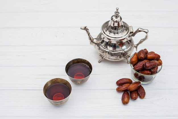 Dates fruit with teapot on table