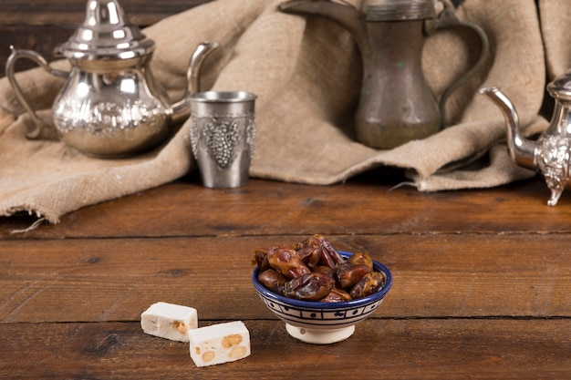 Dates fruit with turkish delight on table