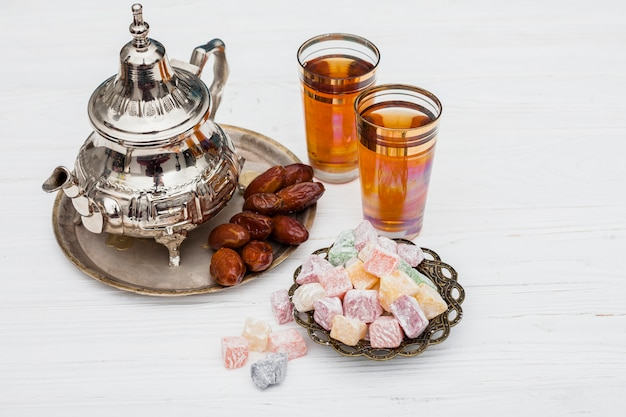 Dates fruit with turkish delight and teapot
