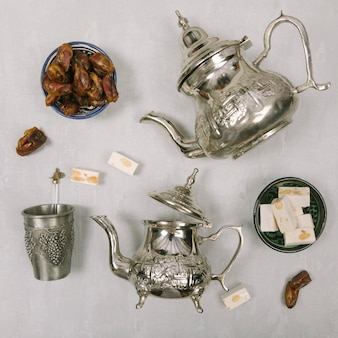 Dates fruit with turkish delight and teapots