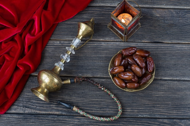 Dates, lantern, red velvet and hookah. ramadan kareem.