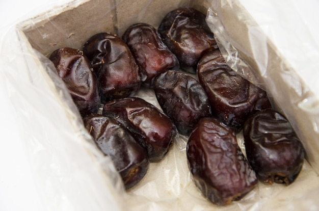 Dates in an open box on a white background