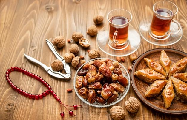 Dates, rosaries and baklava. ramadan. selective focus.
