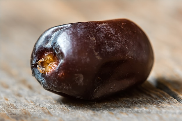 Dates on wooden background