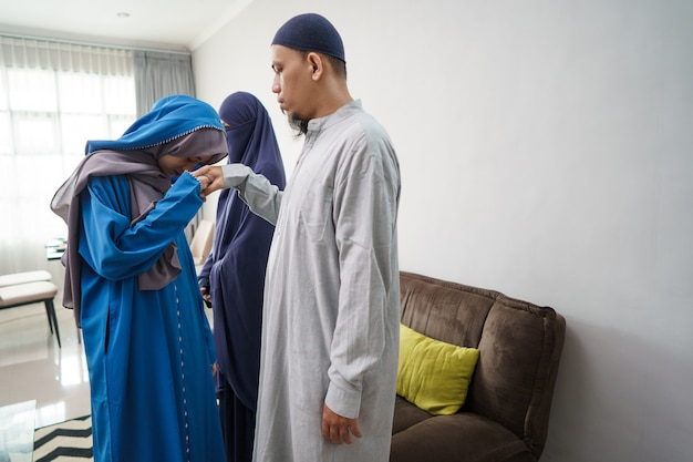 Daughter apologizing to her dad in ramadan eid celebration