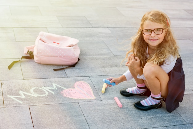 Daughter congratulates her mother and writes with chalk i love mom!