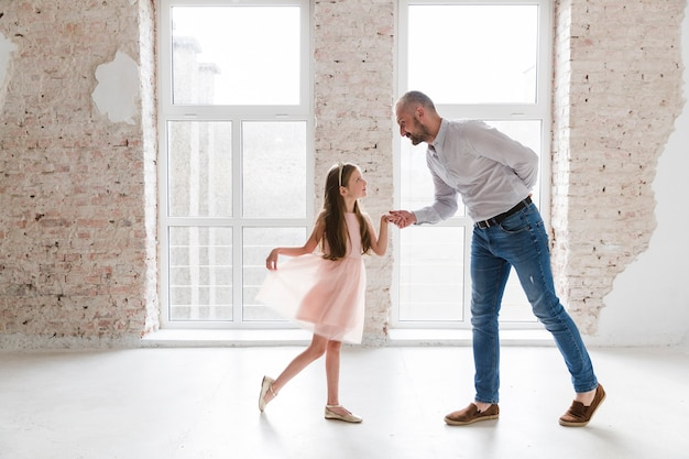 Daughter and dad dancing on fathers day