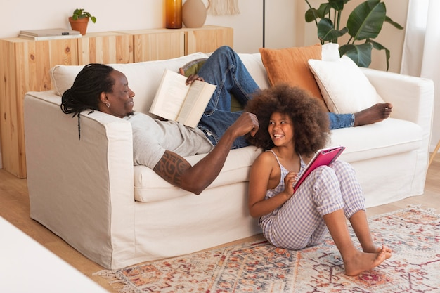 Daughter and father relaxing at home