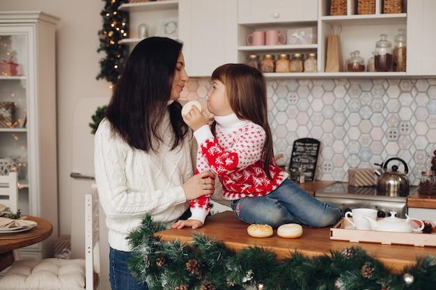 Daughter gives mother a doughnut