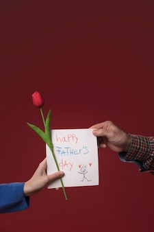 Daughter giving dad fathers day greeting card