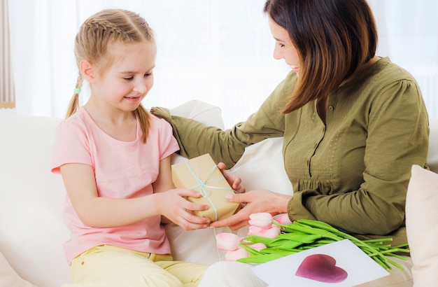 Daughter giving mother presents
