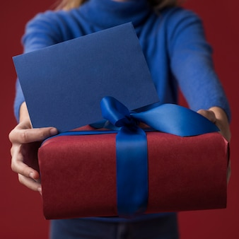 Daughter holding gift for father