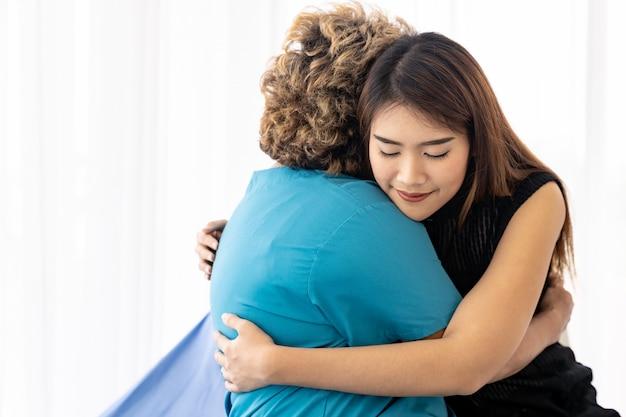 Daughter hug elderly mother
