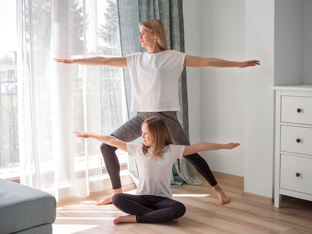 Daughter and mom yoga practice