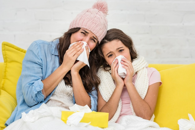 Daughter and mother being sick together