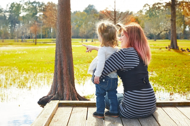 Daughter and mother playing together in park