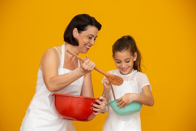 Daughter and mother preparing a recipe