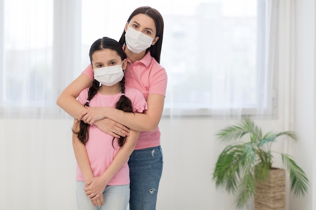 Daughter and mother wearing masks