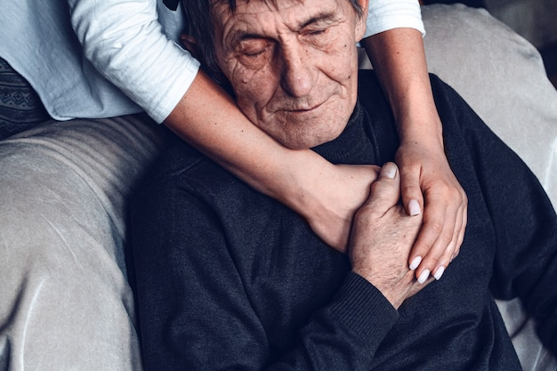 Daughter supports and takes care of her elderly father during the quarantine