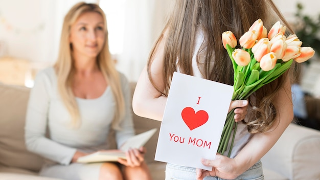 Daughter surprising mother with tulips