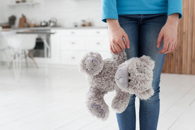 Daughter with teddy bear sad for family breakup