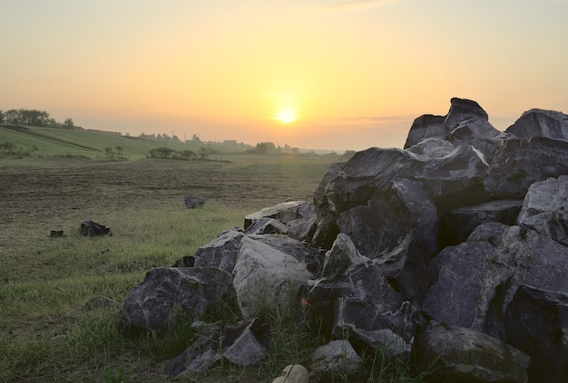 Dawn among meadows and stones