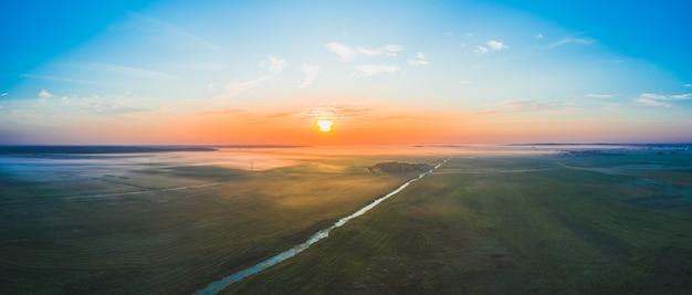 Dawn in the field morning fogs in belarus
