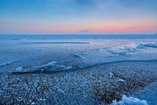 Dawn on an icy lake, dawn winter morning winter landscape