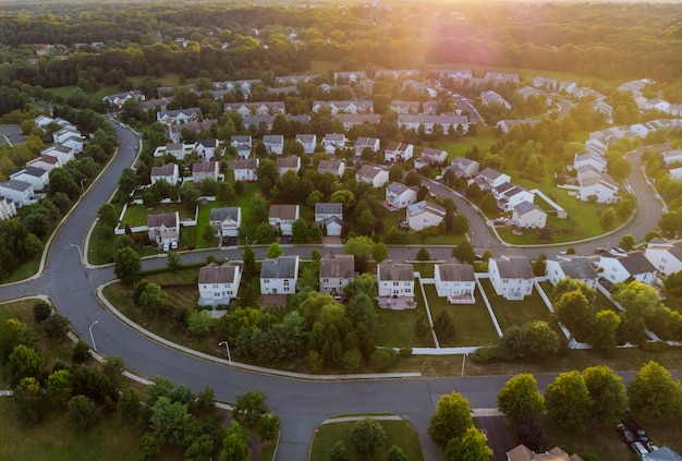 Dawn in the sleeping area of a small town with a forest on the view from a height