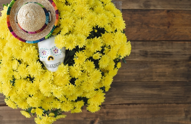 Day of the dead. skull and yellow flowers on wooden background. copy space.