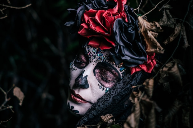 Day of the death portrait of a young woman Free Photo