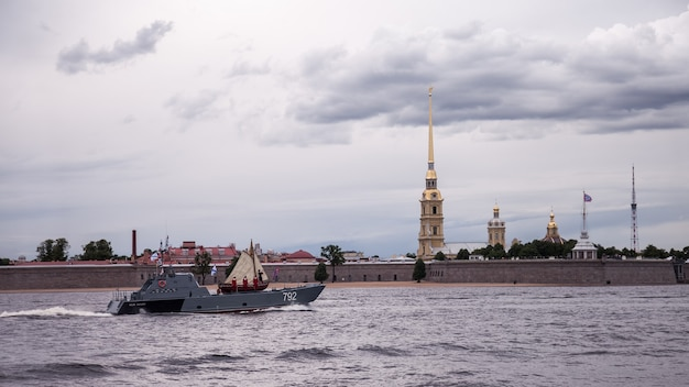 Day of navy of russia, naval parade, military destroyers on neva river