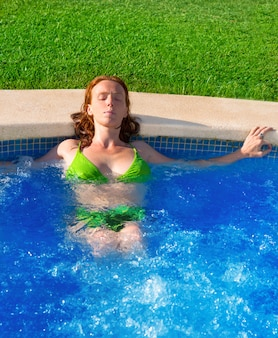 Day spa outdoor woman relaxed on blue pool