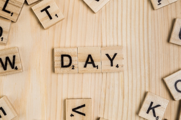 Day word on wooden tiles