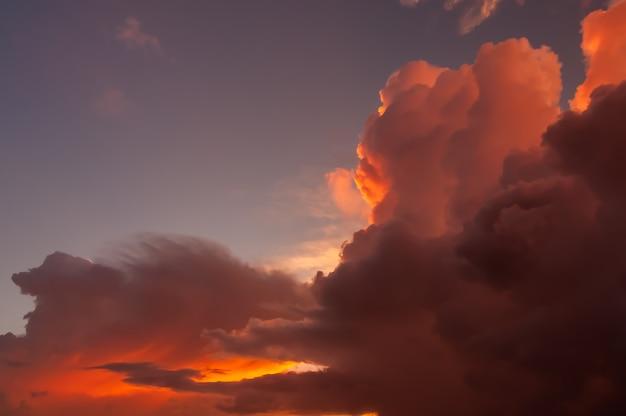 Dazzling pink cumulonimbus clouds illuminated by a magic sunlight