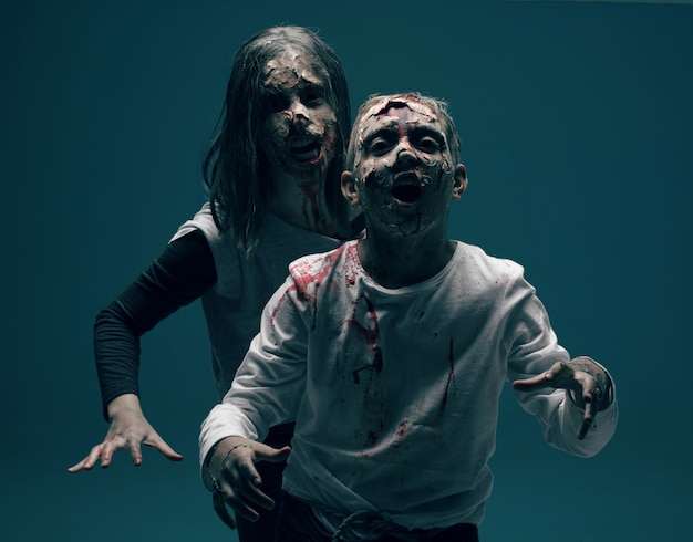 Dead woman and boy zombies. horror halloween concept
