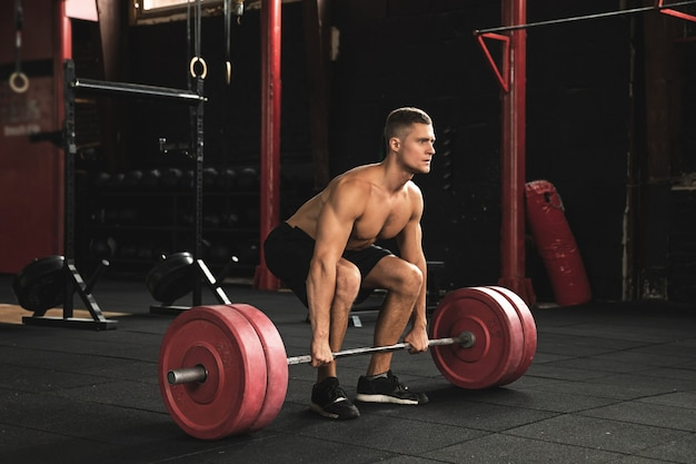 Deadlift exercise. man during his workout in the gym