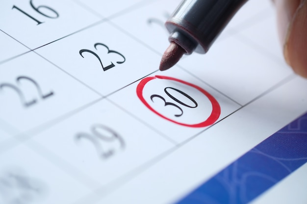 Deadline concept with red mark on calendar date.