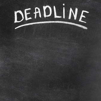 Deadline text written on black chalkboard with chalk