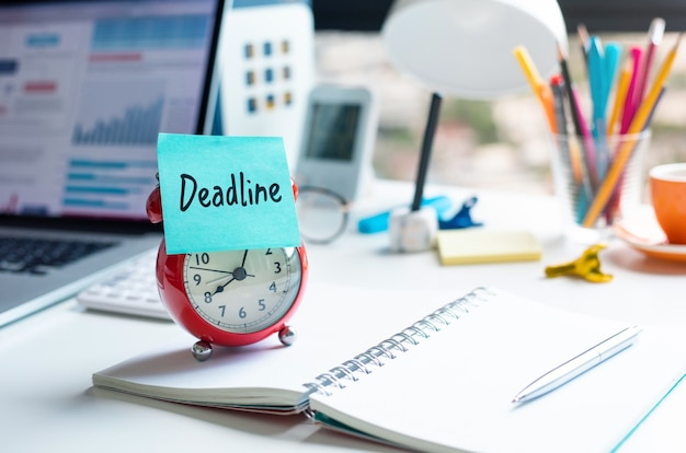 Deadline and work concepts with text on alarm clock on deskmotivation and management