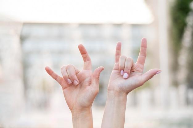 Deaf women communicating through sign language