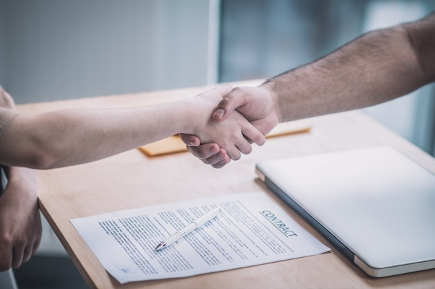 Deal. close up picture of a handshake between the partners